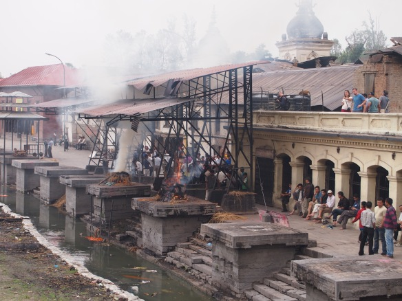 A Hindu cremation taking place at Pashupatinath Temple, Kathmandu