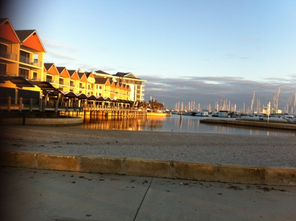 The early morning sun hits Dolphin Quay